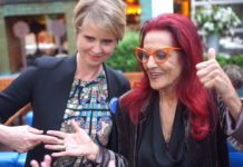 Cynthia Nixon and Patricia Field holding the infamous Carrie necklace on the 20th anniversary of Sex And The City.